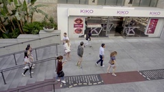 People walking into Hollywood and Highland Mall with stairs in Los Angeles Stock Footage