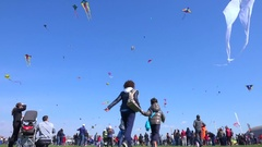 Blue sky with many kites flying during the Kite Festival. Stock Footage