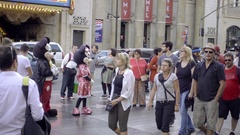 Mickey Mouse performer in costume with tourists on Hollywood Boulevard LA Stock Footage