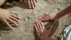 Couple hands forming heart shape from sand. Love symbol. Honeymoon vacation. Stock Footage