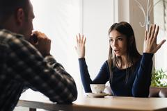 Young couple arguing in a cafe. Relationship problems Stock Photos