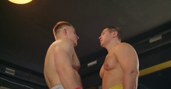 Two boxers face-off looks for each other before fight 4k video in boxing ring Stock Footage