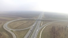 Aerial View Of Freeway traffic on foggy day Stock Footage