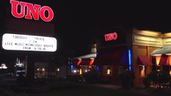 4K Uno Italian bar and grill pizzeria restaurant, customers entrance Stock Footage
