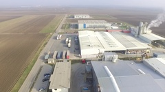 Aerial View Over Fields And Hedgerows And Industrial Buildings zone Stock Footage