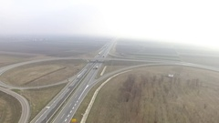 Aerial View Of Freeway intersection traffic on foggy day Stock Footage