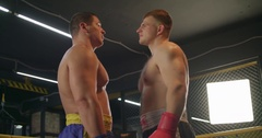 Two boxers face-off looks each other before fight 4k video in boxing ring Stock Footage