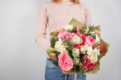 Florist at work. Make rich bouquet diferent color and flowers. Bunch in their Stock Photos