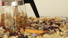 Teapot with different kind of healing herbs 2 Stock Footage