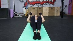 Girl doing sit ups in an exercise room with a gym mat Stock Footage
