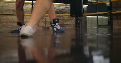 Two boxers sparring training in boxing ring 4k video. Legs foot ring floor Stock Footage