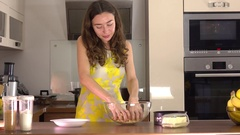 Beautiful young woman making dessert at home Stock Footage