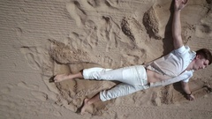 Man relax on beach. Man lying on sand. Beach relax. Man relaxing on sand Stock Footage