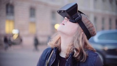 Girl trying virtual reality mask, close up Stock Footage
