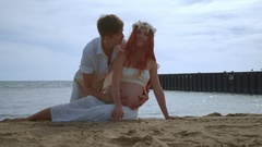 Pregnant couple kissing. Love couple kissing on beach. Couple in love on beach Arkistovideo