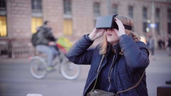 Girl trying virtual reality mask Stock Footage