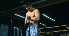 Boxer protects his hand wrist wrap before fight 4k video. Fighter boxing club Stock Footage
