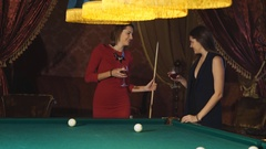 Beautiful woman in red evening dress playing pool Stock Footage