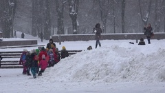 Group of children enjoy snow blizzard in winter time. Arkistovideo
