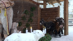 Traditional european Christmas crib nativity scene. Blizzard snow fall Stock Footage