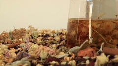 Teapot with different kind of healing herbs  Stock Footage