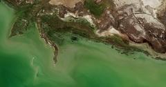 High-altitude overflight aerial of coastland along the Northeast Caspian Sea Stock Footage