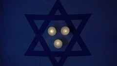 Extinguished the candles on the flag of the flag of Israel Stock Footage