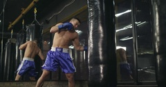 Boxer training punching bag 4k video. Fighter blows jab cross punch Stock Footage