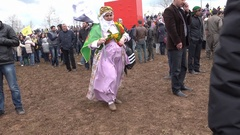 Newroz in Turkey. Kurdish lady walking with the Ocalan's flag. Stock Footage