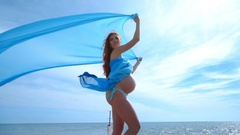 Pregnancy concept. Pregnant woman enjoy summer vacation Stock Footage