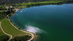 Flying over scenic lake sunny day Stock Footage