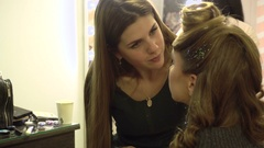 Make-up artist paints eyes girl close-up Stock Footage