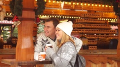 Eve of Christmas. Cute young couple has a good time at the Christmas bazaar. Stock Footage