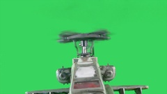 Military gunship flying on greenscreen, camera moving away from helicopter Stock Footage