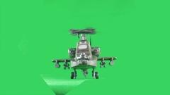 Military gunship flying towards camera on greenscreen Stock Footage