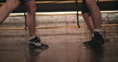Two boxers training boxing ring 4k video. Close-up legs foot with shoes in floor Stock Footage