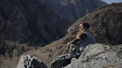 Backpacker Rests Next To Her Pack And Looks Out At Mountain Vista Stock Footage