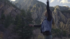 Portrait Of Happy Young Woman Taking A GoPro Video Of Herself In Utah Mountains Stock Footage