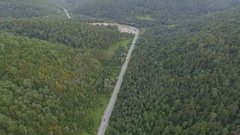 Truck drives in mountain forest road aerial view top Stock Footage