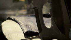 Man irons jeans on the ironing board, close-up Stock Footage