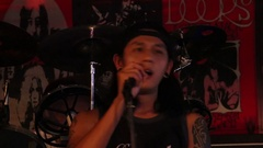 Thai singer sings the song at Hot Tuna bar on Walking Street. Thailand, Pattaya Stock Footage