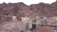 Hoover Dam with pedestrian traffic crossing over walkway 4k Stock Footage