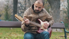 Rock busker musician playing electric guitar 4K stock footage Stock Footage