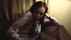 Beautiful brunette falls asleep on the couch Stock Footage