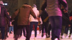 Concept Friendship and Love. Crowd at Night City Skating Rink. Falling Snow Stock Footage