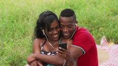 Couple Listening To Music And Watching Video On Mobile Phone Arkistovideo