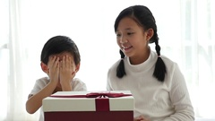 Cute Asian children opening gift present box Stock Footage