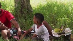Dad Mom Son Eating Snack During Picnic In City Park Stock Footage