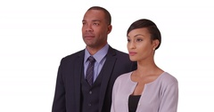Black business couple posing for a portrait on a white background Stock Footage