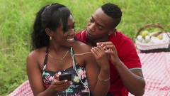 Couple Listening To Music And Watching Video On Mobile Phone Stock Footage